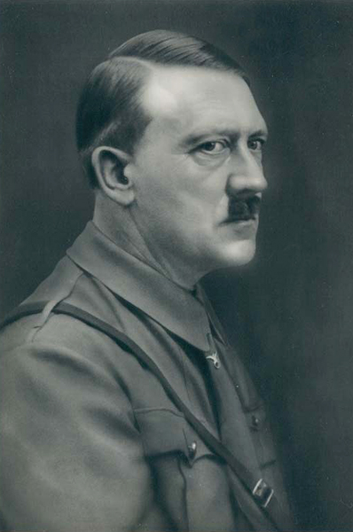 Adolf Hitler seen wearing the supporter's pin of the NSDAP